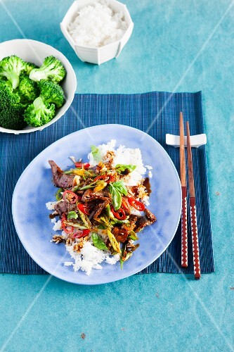 Marinated stir-fried beef with vegetables on a bed of rice