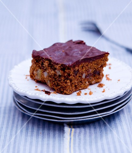 Slice of chocolate spiced cake on a stack of plates