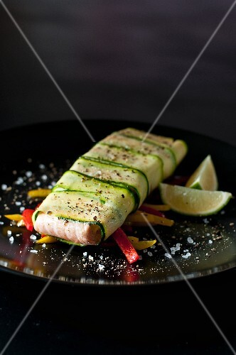 Salmon wrapped in courgette strips with peppers