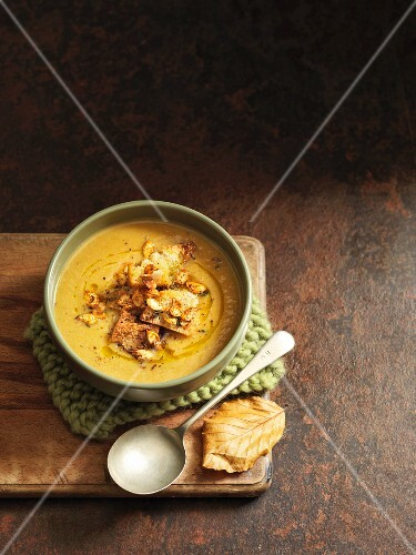 Pumpkin soup with bread and pumpkin seeds