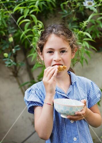 A girl eating a flapjack