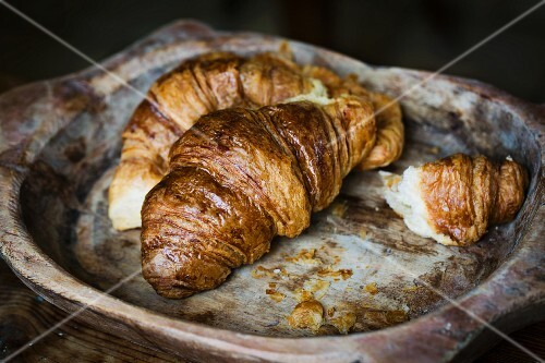 Croissant in a wooden bowl