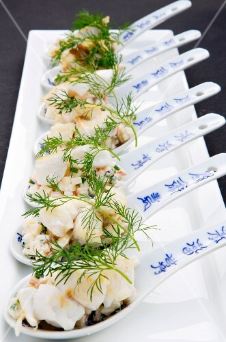 Fried cod with apple cream on canapé spoons