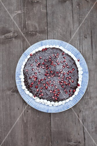 Chocolate cake with pomegranate seeds and marshmallows