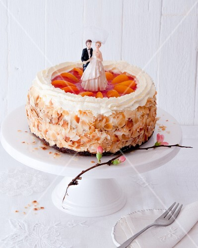 A wedding cake with apricots, cream and flaked almonds