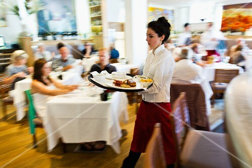 A waitress serving in The Seafood Restaurant in Padstow (Cornwall, England)