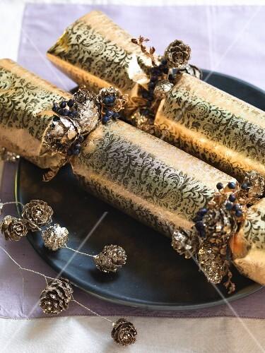 Shiny gold Christmas crackers