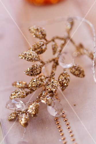 Golden branch as Christmas table decoration