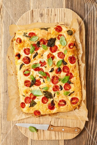 Focaccia with cherry tomatoes, goat's cheese and basil