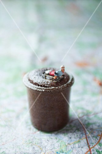 Chocolate mousse decorated with a sledge on a map