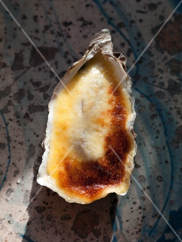 A gratinated oyster in a shell