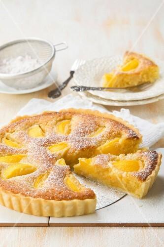 Peach and frangipani tart with powdered sugar
