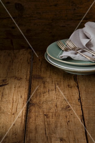 Rustic plates on a wooden surface