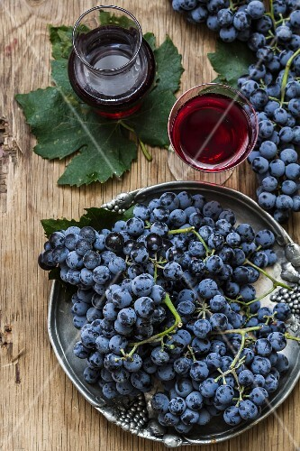 An arrangement of grapes and red wine