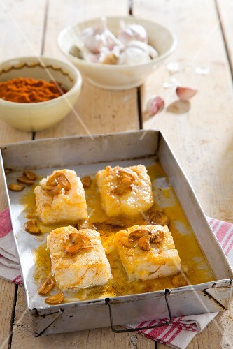 Bacalao a la Llauna (stock fish with peppers, white wine and garlic, Spain)