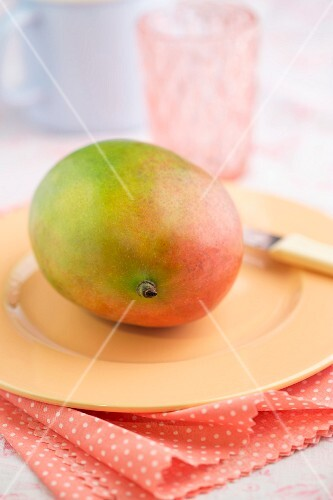 A fresh mango on a plate
