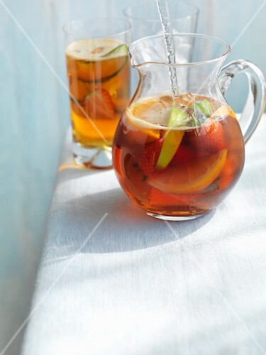 Pimms in a glass jug and in a glass