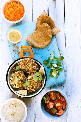 Falafel with hummus, tomato salad, unleavened bread and grated carrots