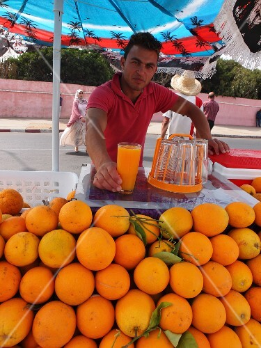 A young man selling freshly pressed orange juice on the outskirts of El Jadida, Morocco