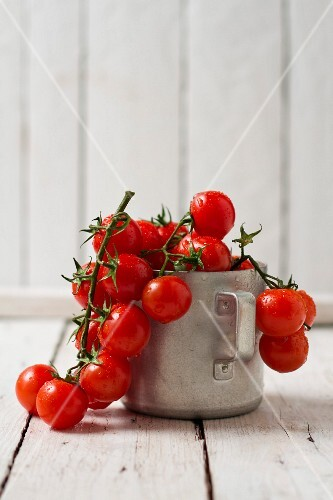 Fresh cherry tomatoes in a metal cup