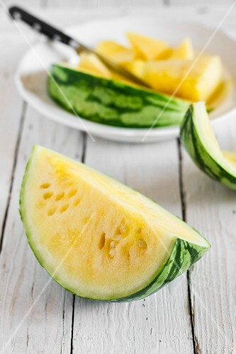 A yellow watermelon cut into wedges