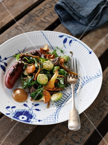 Sausage with a chanterelle mushroom and Brussels sprout salad