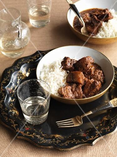 Pork vindaloo with rice (India)