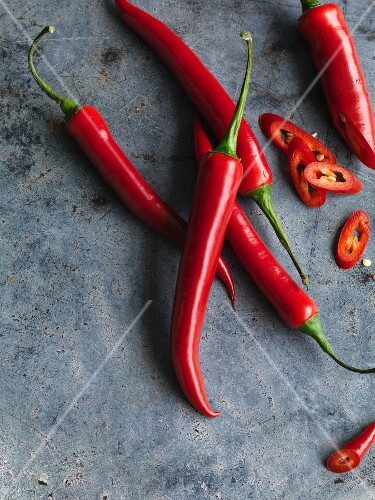 Fresh red chilli peppers, partially sliced