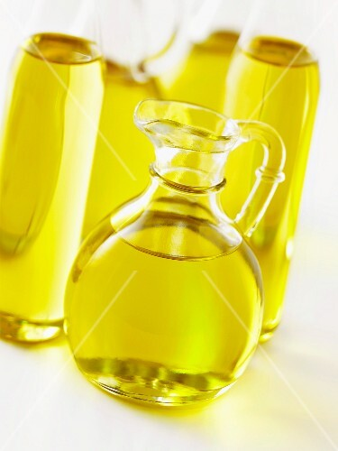 Bottles of oil and a carafe of oil