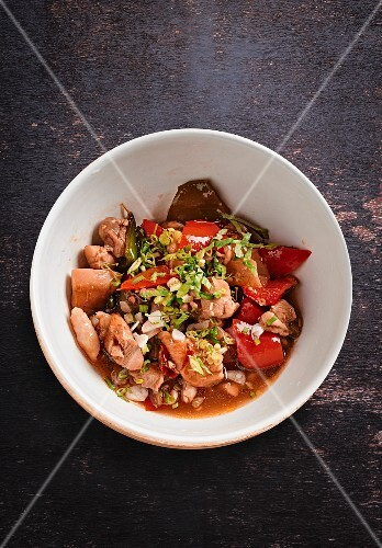 Chicken stew with peppers and spring onions