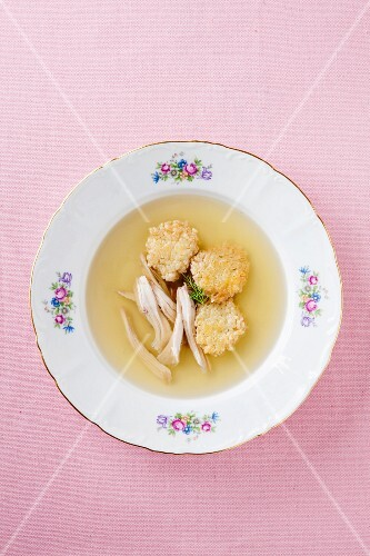Broth with meatballs and chicken strips