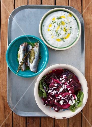Greek mezze: fish, yoghurt and beetroot salad