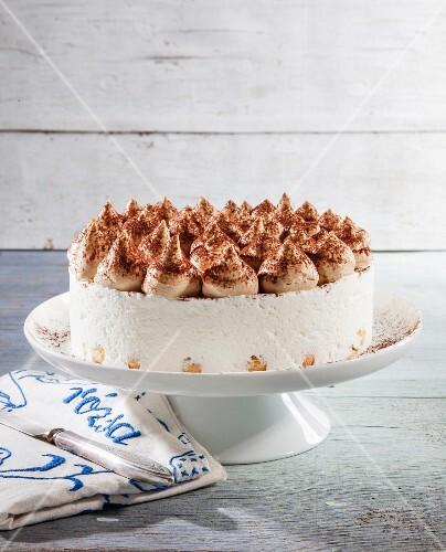 Tiramisu torte on a cake stand