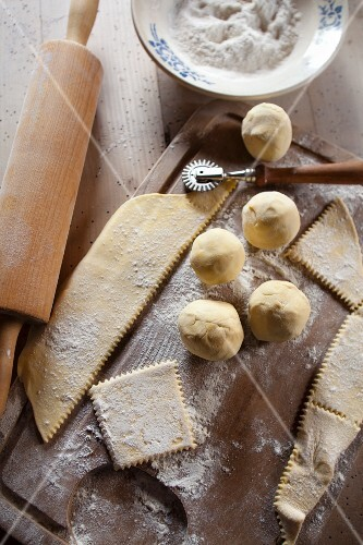 Dumpling dough, flour, a pastry cutter and a rolling pin