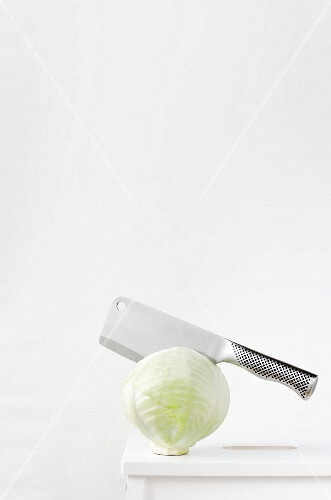 White cabbage with a meat cleaver