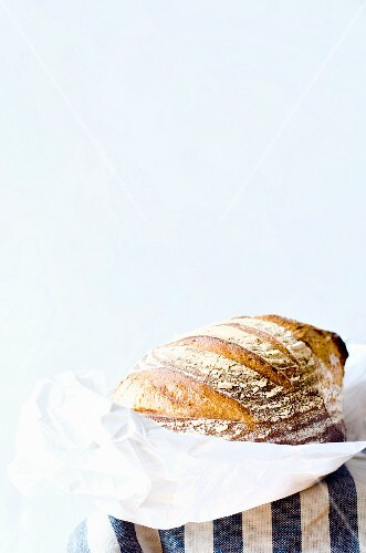 A loaf of bread on white paper