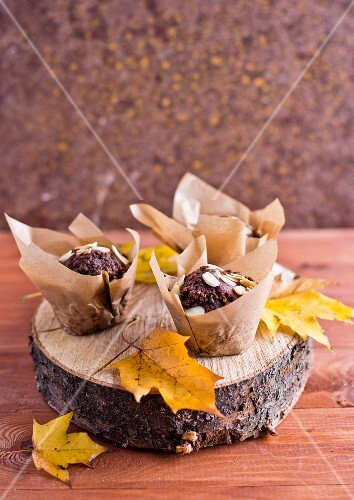 Autumnal chocolate muffins with flaked almonds