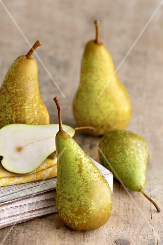 Pears on a light wooden surface