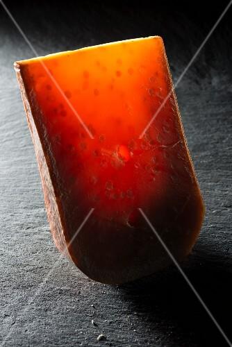 Ripe Gouda on a slate surface