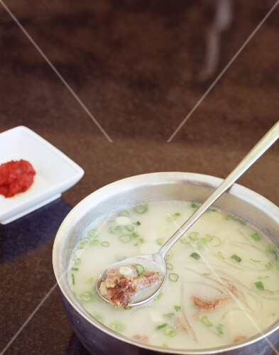 Korean beef bone soup served with spicy chilli paste