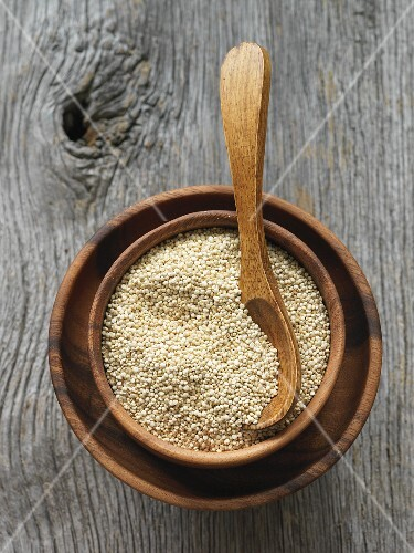 Quinoa in a wooden bowl with a spoon