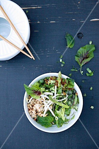 Pho Bo (Vietnamese noodle soup) with chicken, bean sprouts, herbs and lemongrass