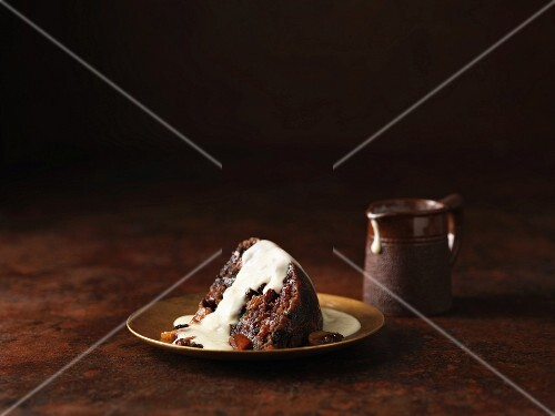 A slice of fruit cake with brandy and armagnac sauce