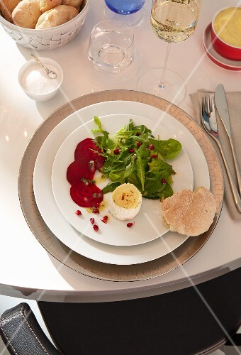 Baked goat's cheese with beetroot and mixed leaf salad with pomegranate seeds