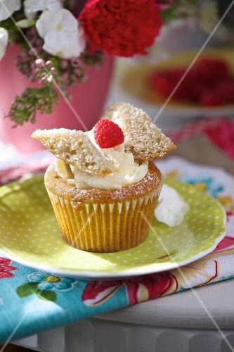 A lemon and raspberry cupcake