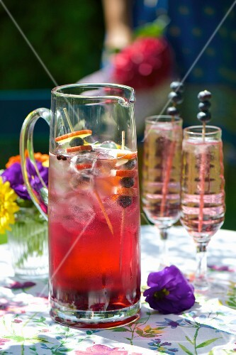 A summer drink made with blueberries and blackberry juice