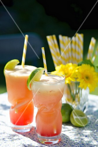 Two guava drinks with passion fruit juice and limes