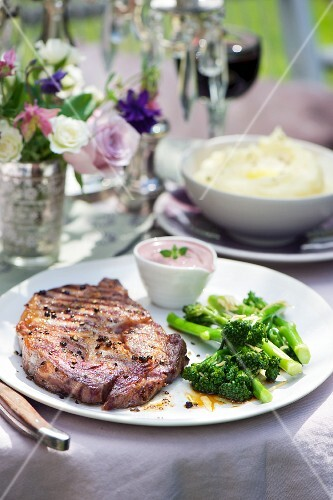 A rib-eye steak with broccoli florets served with a red wine and mustard dip with horseradish