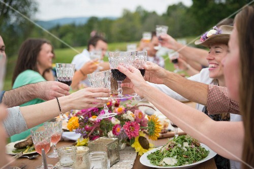 Family and friends raising a toast at outdoor meal