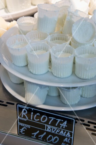 Ricotta on a stand in a cheese shop